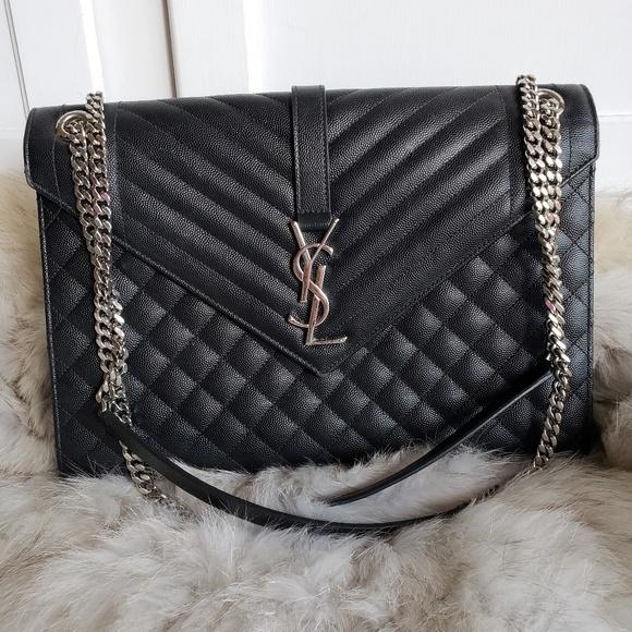 ee36a4d1021 YSL Cassandra Black Calfskin Crossbody Handbag. M_5bb561f6d6dc522f52dafcb4